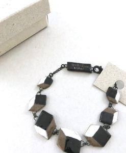 Unexpected bracelet made of several ceramic trompe l oeil cubes.