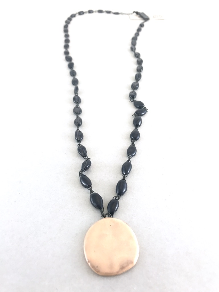 Mid length ceramic navy necklace made of cowrie shaped beads. Made in France