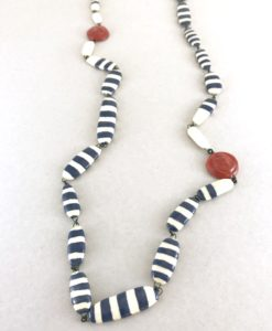 A ceramic chain inspired by sailor suit code , striped and anchor stamped beads for a free eccentric chic style.