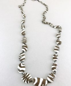 Original ceramic necklace hand made consisting of zebra patterned beads done one by one in France