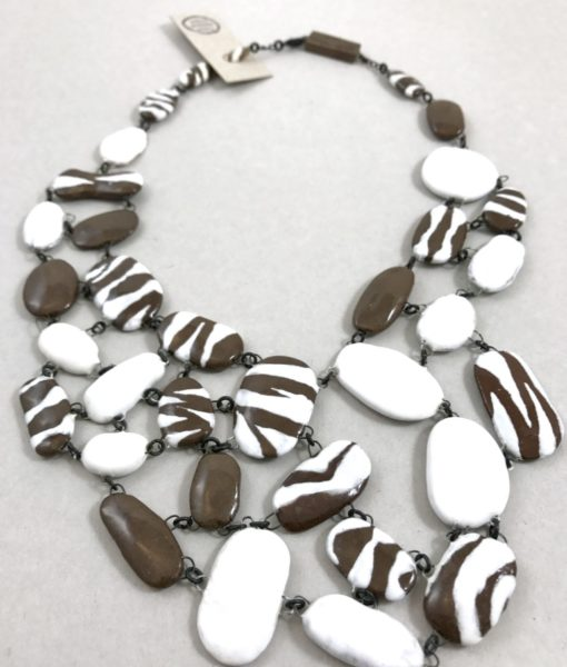Exceptional plastron necklace made of an mix of brown, White, zebra patterned ceramic hand made flat beads.